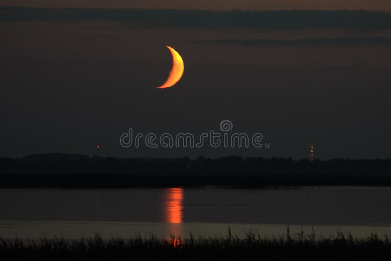 Moon set time and orange sky stock images