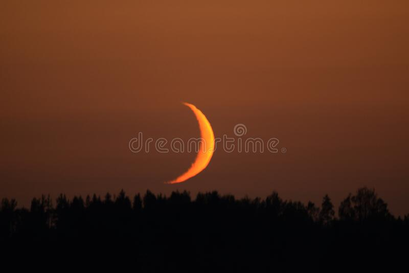 Moon set time and orange sky stock photography