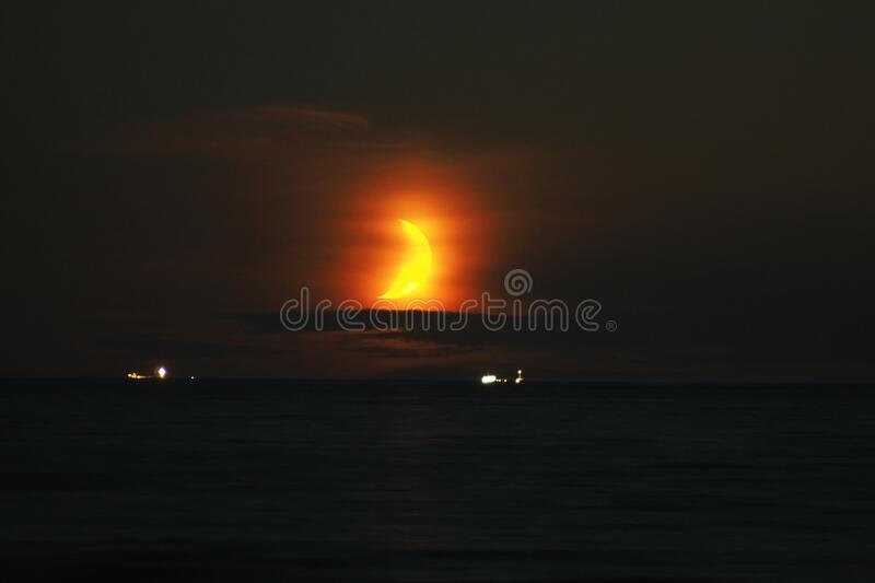 Moon set time and orange sky observing royalty free stock photography