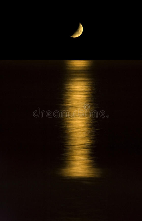 Moon setting on the ocean. royalty free stock images