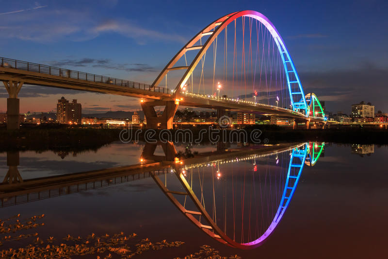 The moon shape bridge at New Taipei City, Taiwan. Around sunset time royalty free stock photo