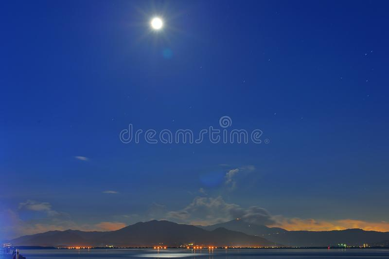 Moon on Shenzhen Bay stock photography