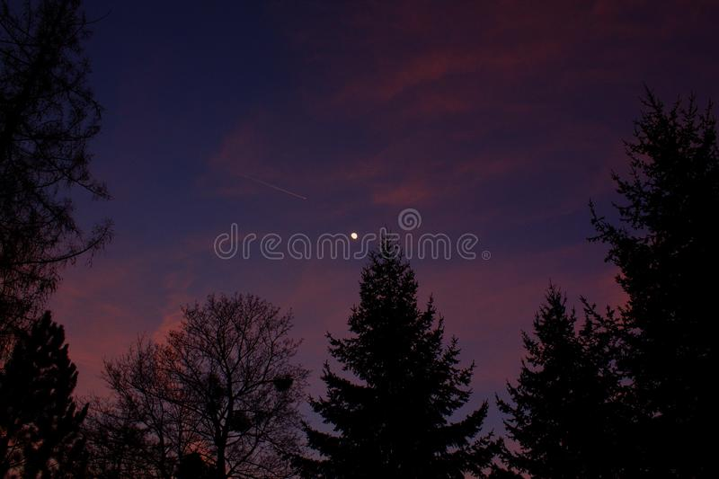 The moon shining in the evening with plane - in winter season royalty free stock images