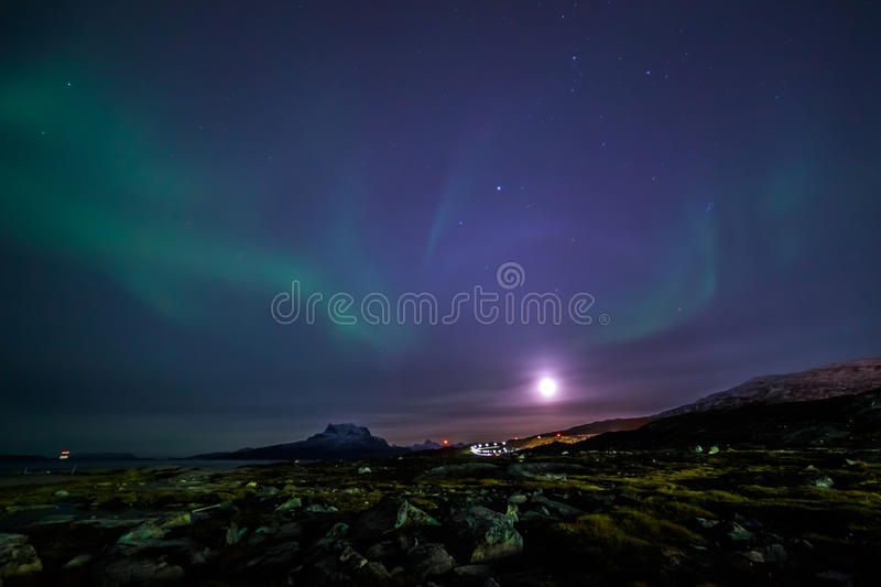 Moon shining and the northern lights, nearby Nuuk, Greenland. October 2015 royalty free stock photo