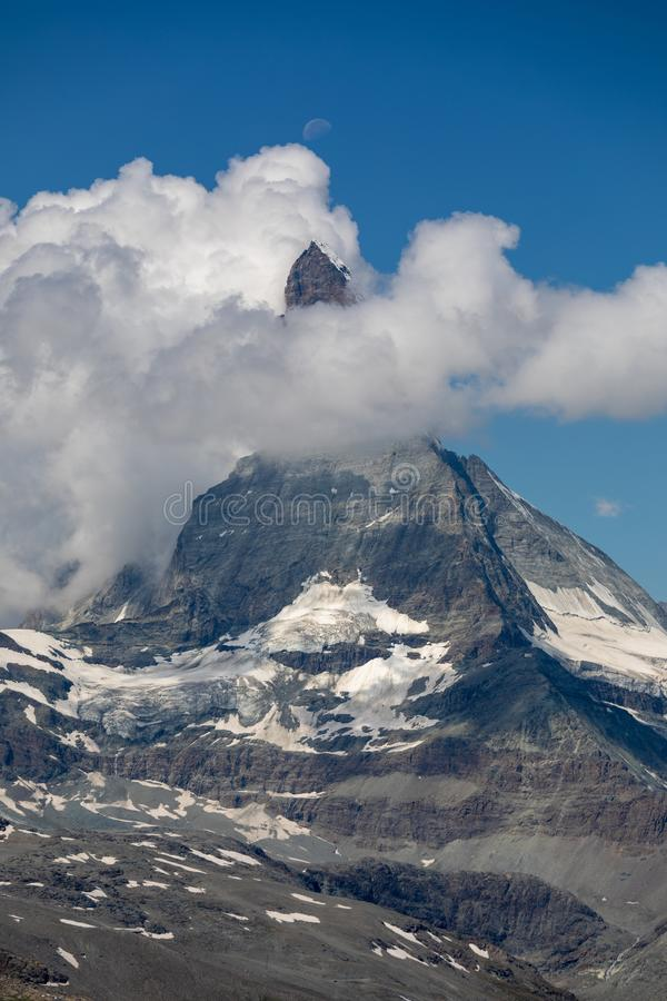 Moon Shining Over The Famous Matterhorn With Clouds And ...