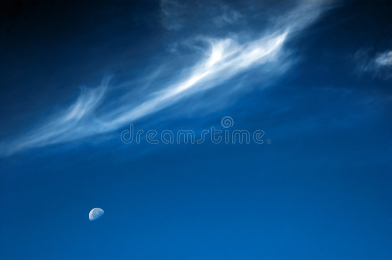 Moon and silver clouds. On the dark blue sky stock photos