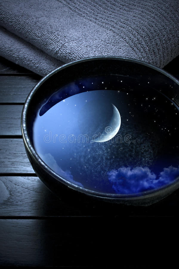Moon Sky Water Spa. A ceramic bowl full of water that is reflecting a night sky with stars and moon