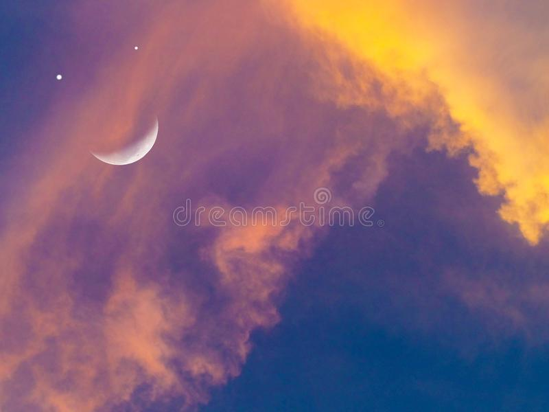 Moon smile and sunset sky orange cloud. Elements of this image furnished by NASA royalty free stock photos