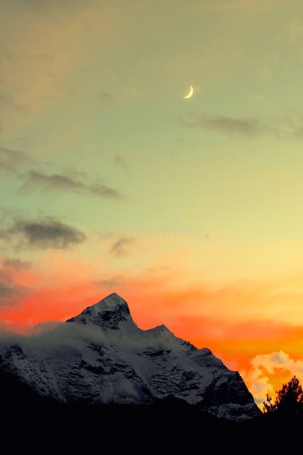 Moon And Snow Mountain Stock Photo