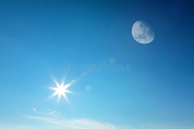 Moon and sun together on sky royalty free stock photo
