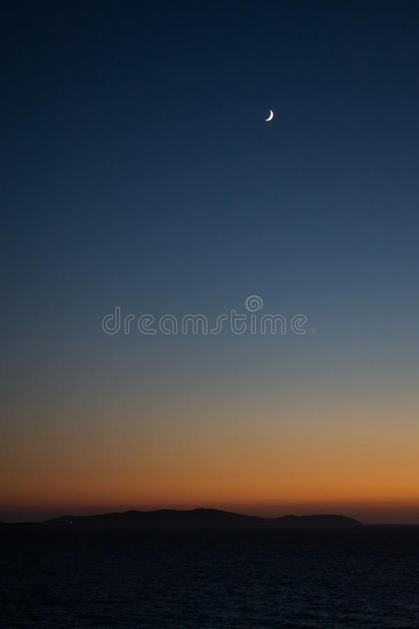 The Moon at Sundown stock image
