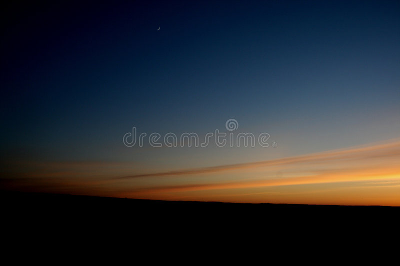 Moon at the sunset royalty free stock photo