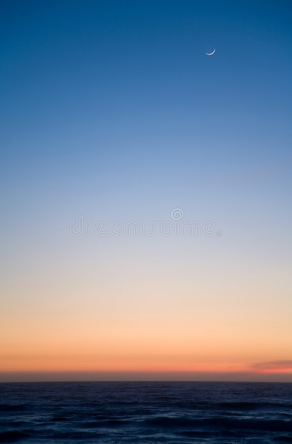 Moon at sunset royalty free stock photography