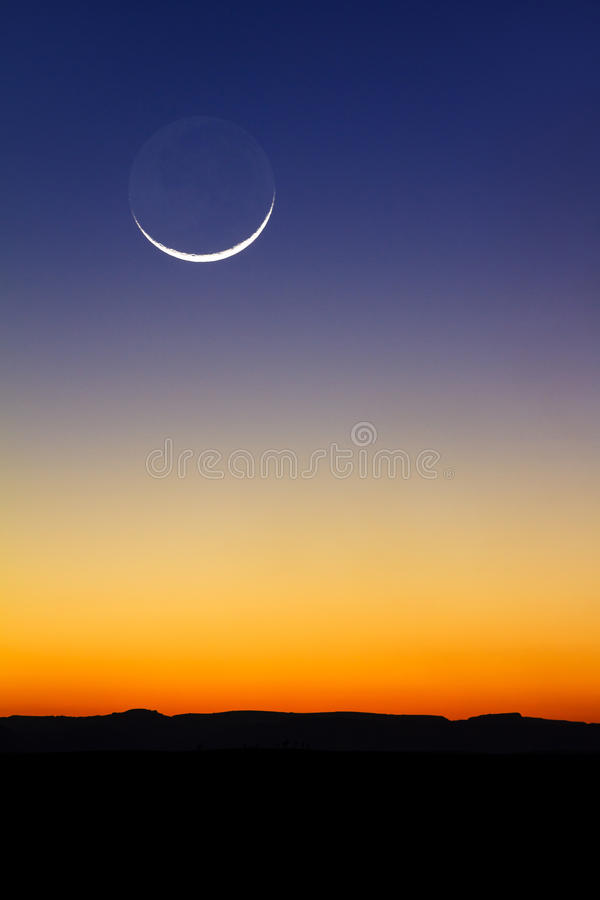 Moon sunset. Beautiful new moon at sunset in Madagascar stock images