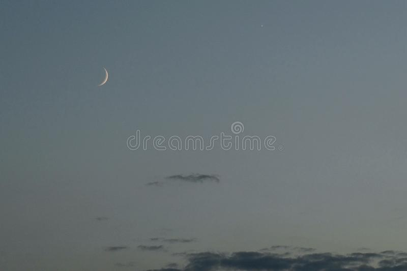Moon and Venus on blue sky royalty free stock photo