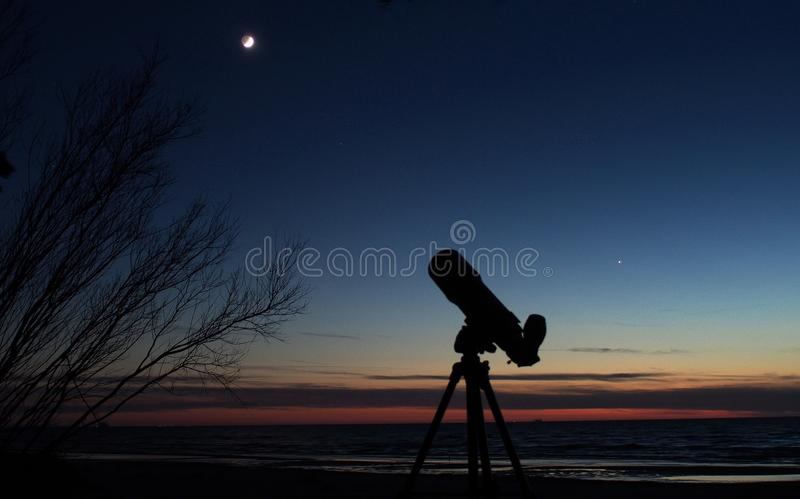Moon and Venus observing after sunset. Moon and Venus observing, stars on blue sky after sunset royalty free stock photo