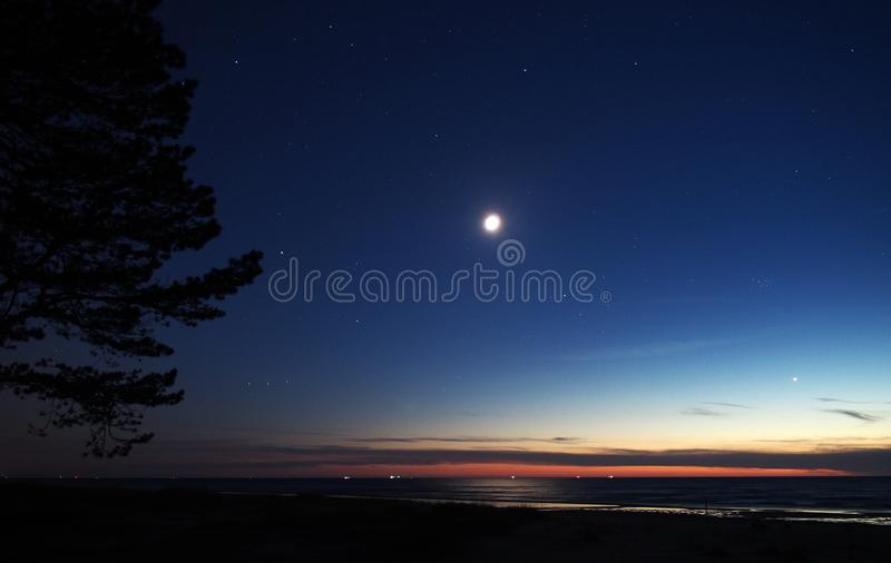 Moon and Venus observing after sunset. Moon and Venus observing, stars on blue sky after sunset stock image