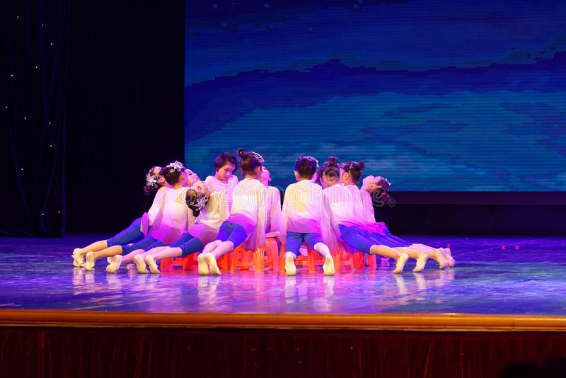 The moon is whispering- Beijing Dance Academy grading test outstanding children`s dance teaching achievement exhibition Jiangxi. Sponsored by the Beijing Dance royalty free stock photo