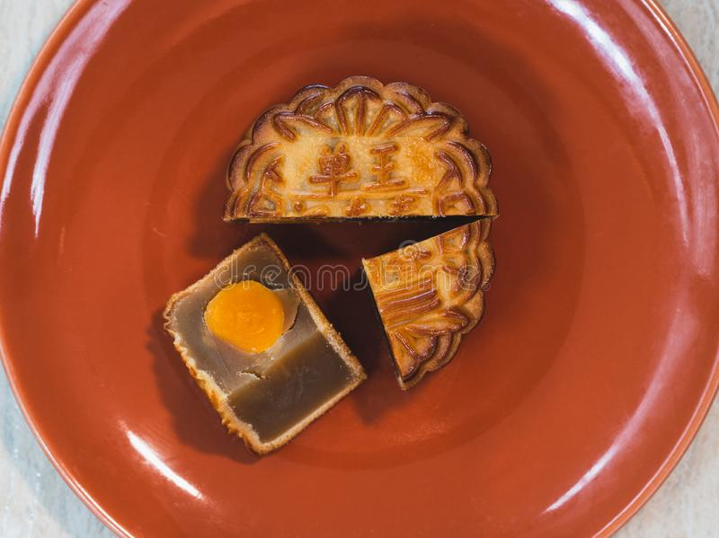 Mooncake with egg yolk on a plate for mid autumn festival royalty free stock photos