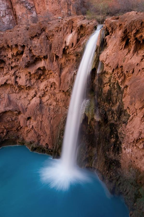 A bird`s eye view of the 200ft Mooney Falls surges in to a beautiful deep blue pool beneath, located on the Havasupai Indian Reser. Mooney Falls is the fourth royalty free stock image