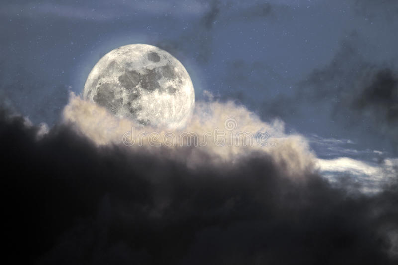Moonlight. Illustration of an interesting full moon in a cloudy night royalty free stock photo