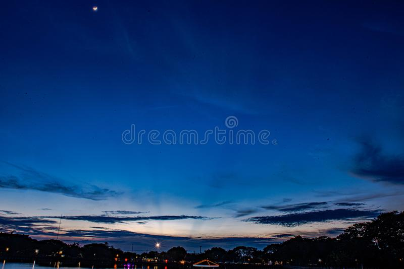Moonlight, blues, sun reflected clouds royalty free stock photo