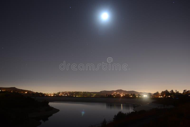 Moonlight over lake stock image