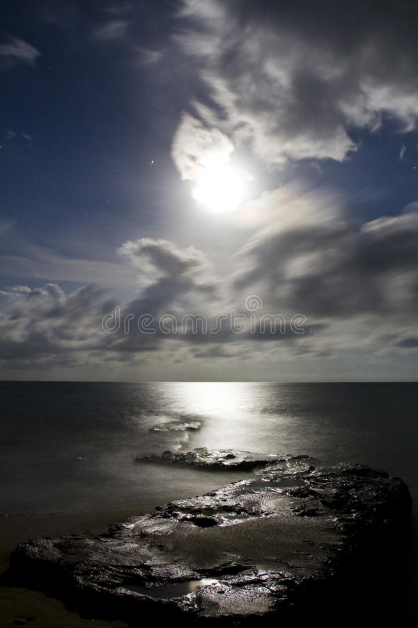 Download Moonlight over ocean beach stock photo. Image of tranquility - 12615660