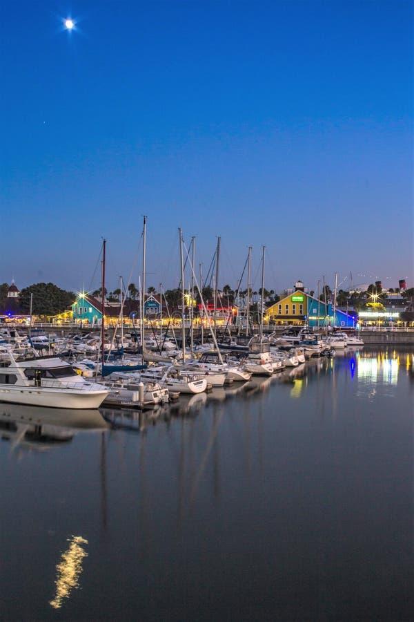 Moonlight over Shoreline Village harbor in Long Beach, California stock photos