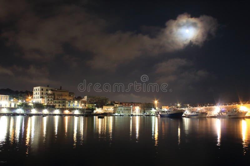The lights in the night. Granatello, Portici, Italy. Moonlight in the Port of Granatello at night, in spring - Granatello, Portici, Italy royalty free stock images
