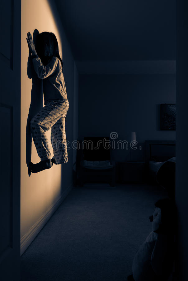 Moonlight. A surrealistic photograph of a levitating child inside a bedroom, in moonlight stock photos