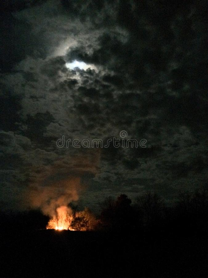 Moonlit Bonfire. Great night for a bonfire while the coyotes chime in stock images