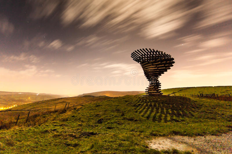 Moonlit Shadow at the Singing Ringing Tree. The Singing Ringing Tree sculpture on the moors over Burnley, Lancashire UK casting a shadow in the moonlight