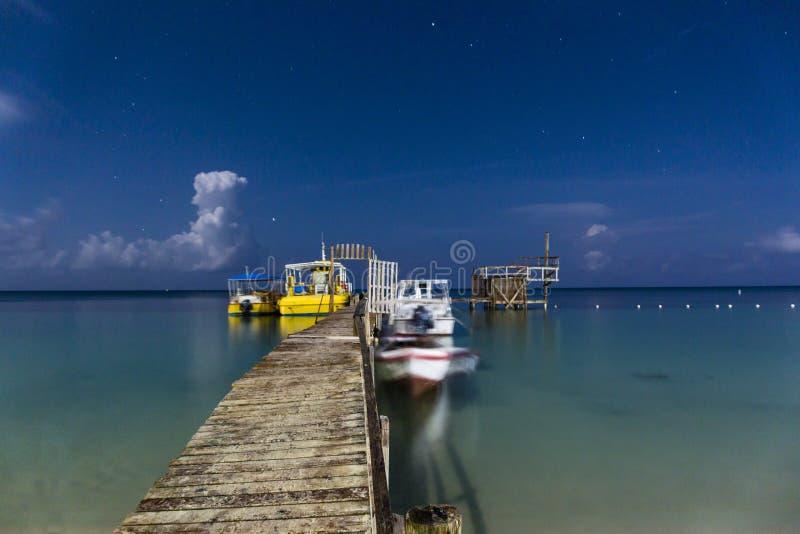 Moonlit West Bay Pier stock photography