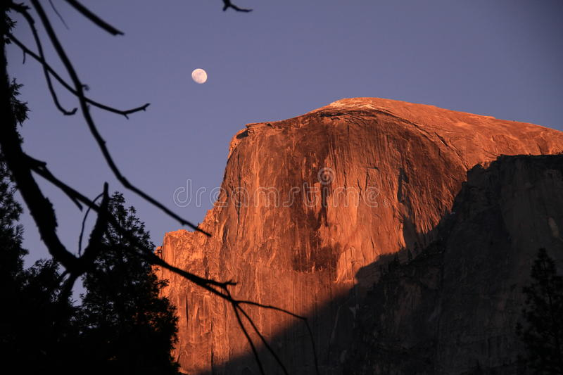 Moonrise over halfdome. The moon rising over Halfdome at sunset royalty free stock photos