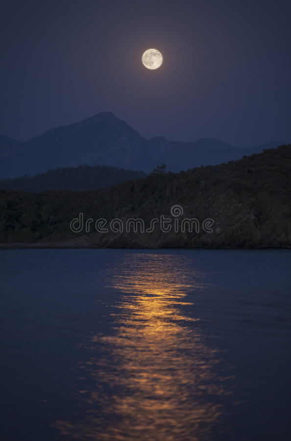 Moonrise over hills stock photography