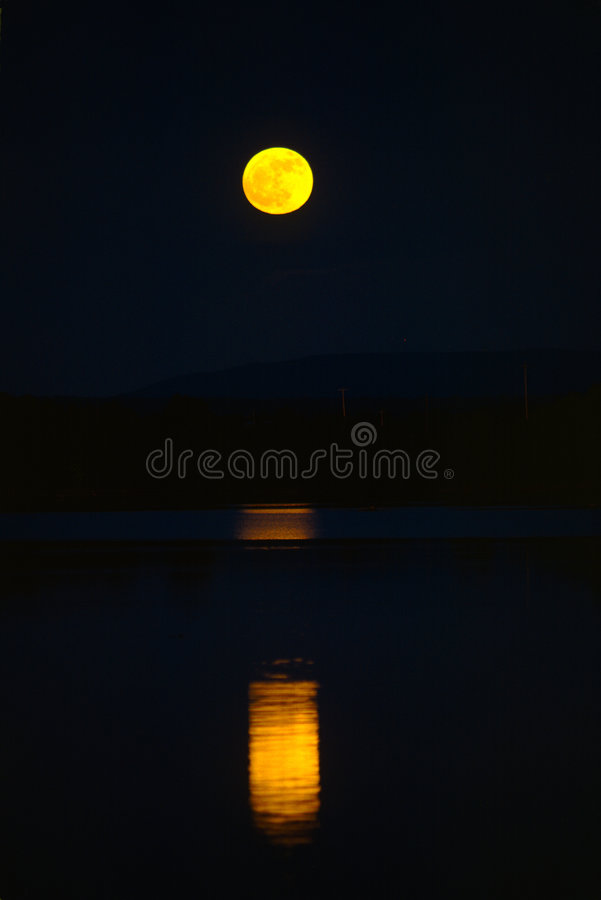 Moonrise over lake royalty free stock photos