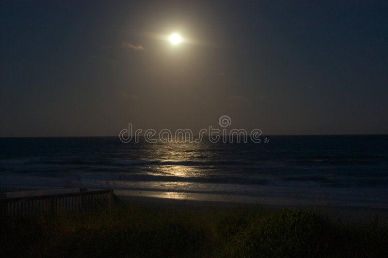 Moonrise over the Ocean stock images