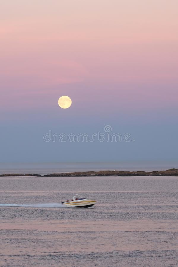 Moonrise over the Pacific ocean stock images