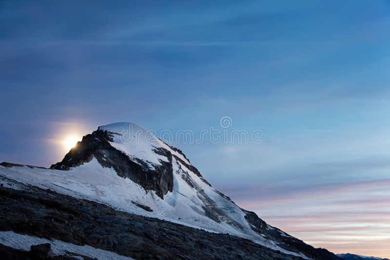 Download Moonrise Over Snowed Mountain Stock Photo - Image: 6069890
