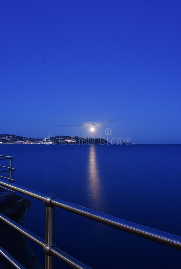 Moonrise over Torquay royalty free stock images
