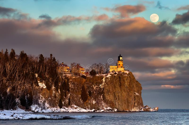 Split Rock Lighthouse in winter. Moonrise and sunset at Split Rock Lighthouse, North Shore of Lake Superior, Minnesota stock photos
