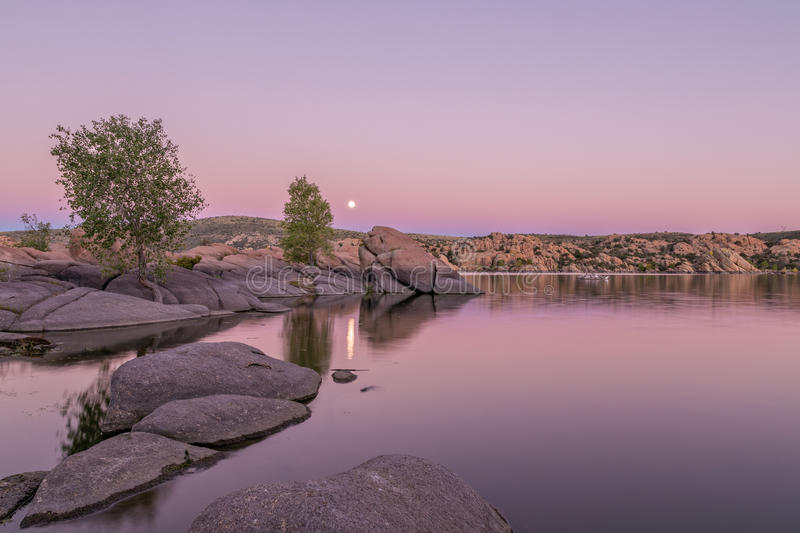 Moonrise at Watson Lake. A full moon rising above Watson Lake Prescott Arizona at sunset stock image