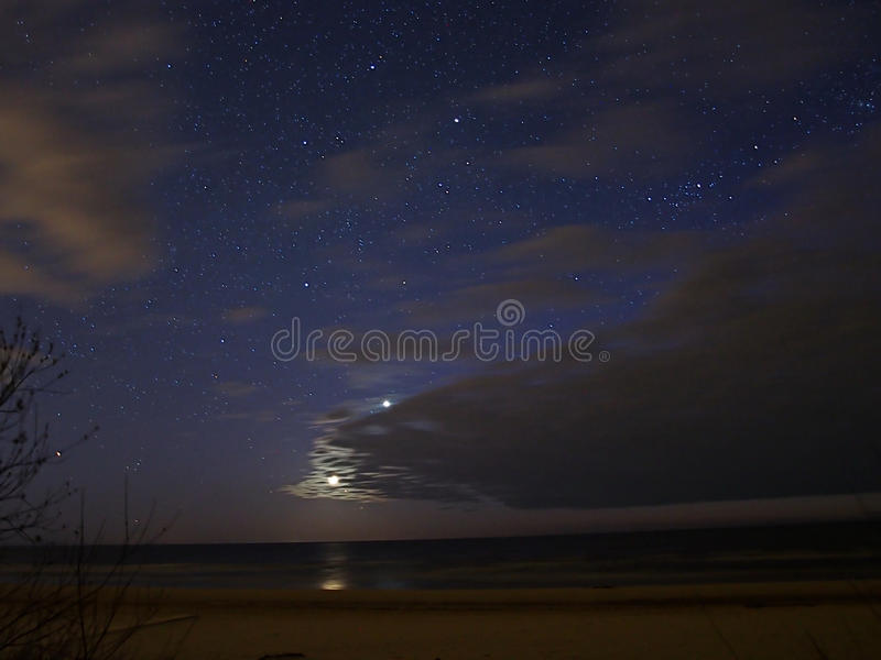 Moon stars and clouds over sea royalty free stock photography