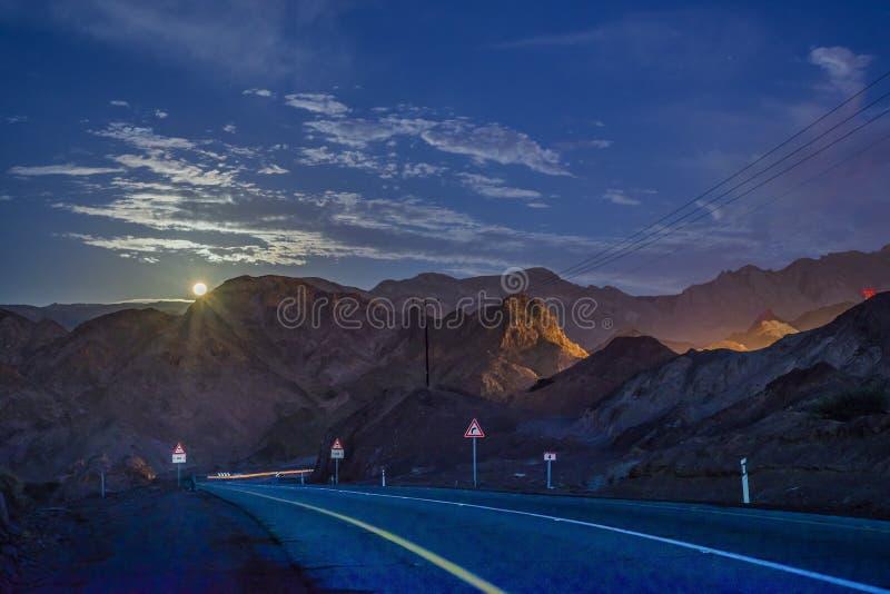 Moonset in the Negev desert roocks stock photography