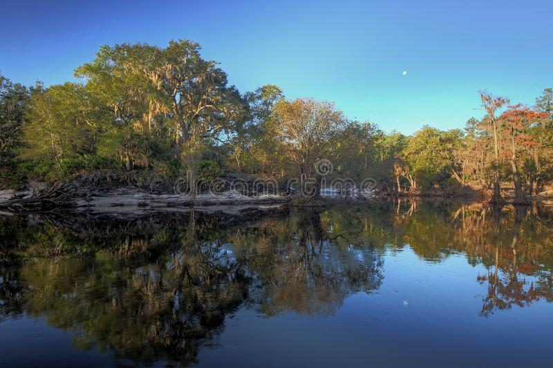 Moon set over the Suwannee River, north Florida stock photography