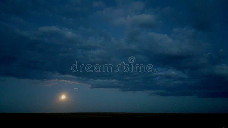 Moonset Texas Panhandle image stock