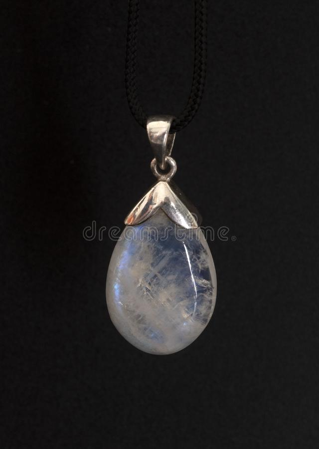 Moonstone in collar. In front of white background stock photo
