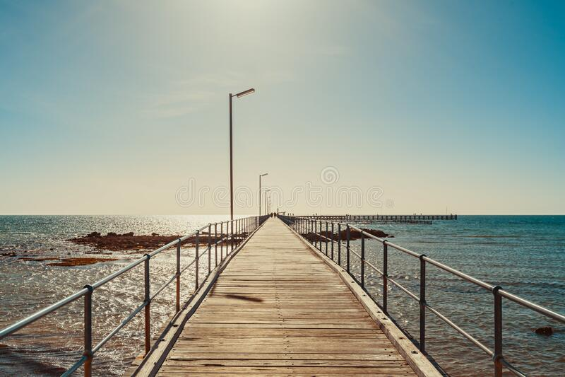 Moonta Bay jetty, South Australia. Moonta Bay foreshore with jetty on a bright day, Yorke Peninsula,  South Australia royalty free stock images