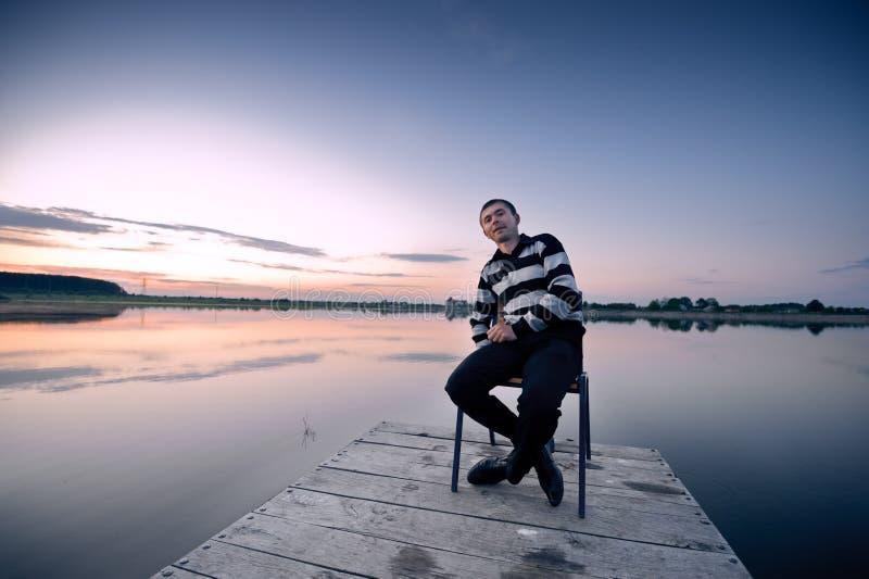 Moorage. Man on chair in moorage royalty free stock photos